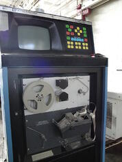 A punched tape reader on a CNC control - Shared through CC 3.0 by Wikipedia user Three Quarter Ten
