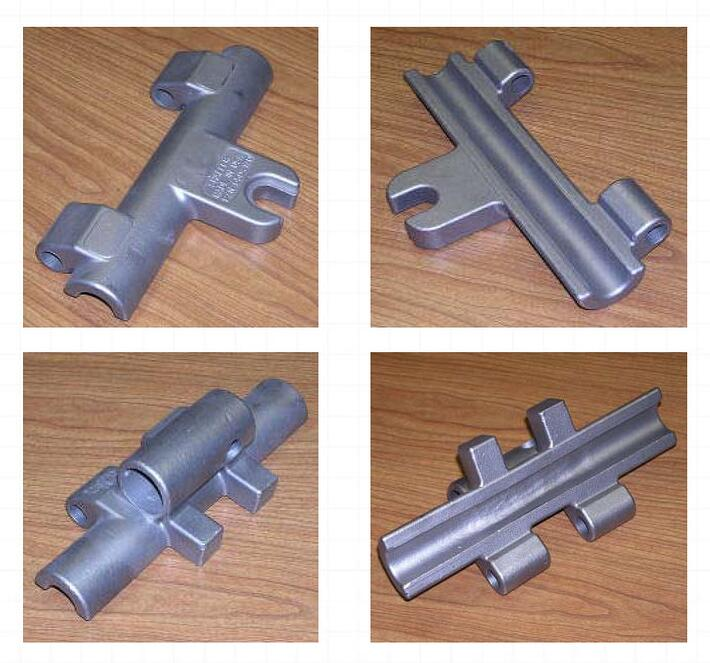 Two castings that make up the majority of the cast part - cable clamp assembly