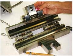 The fabricated part - cable clamp assembly