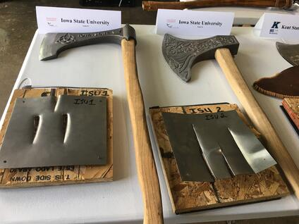 Iowa State University Axes in competition next to pierced steel plates