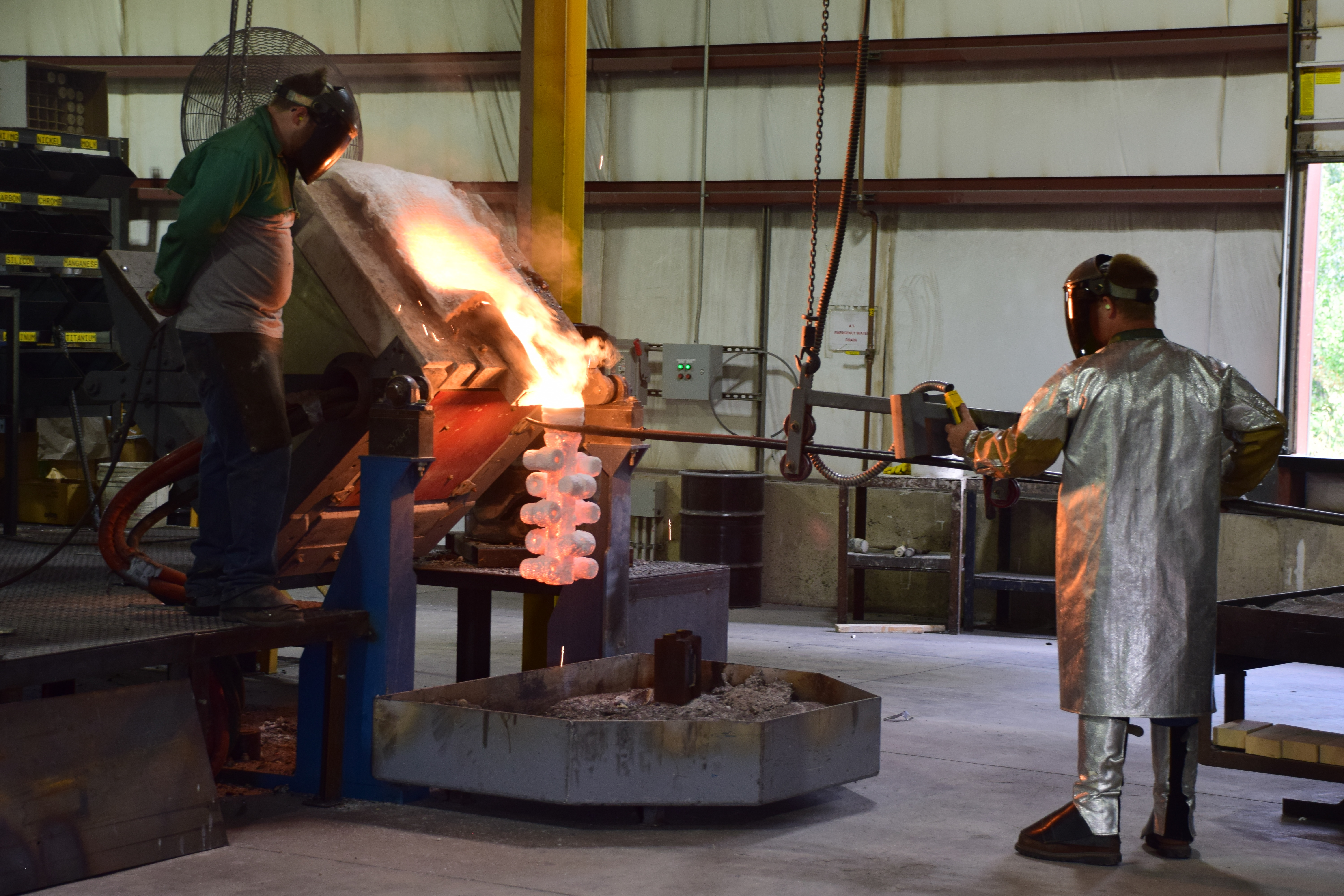 Investment Casting - pouring molten metal into a pre-heated mold